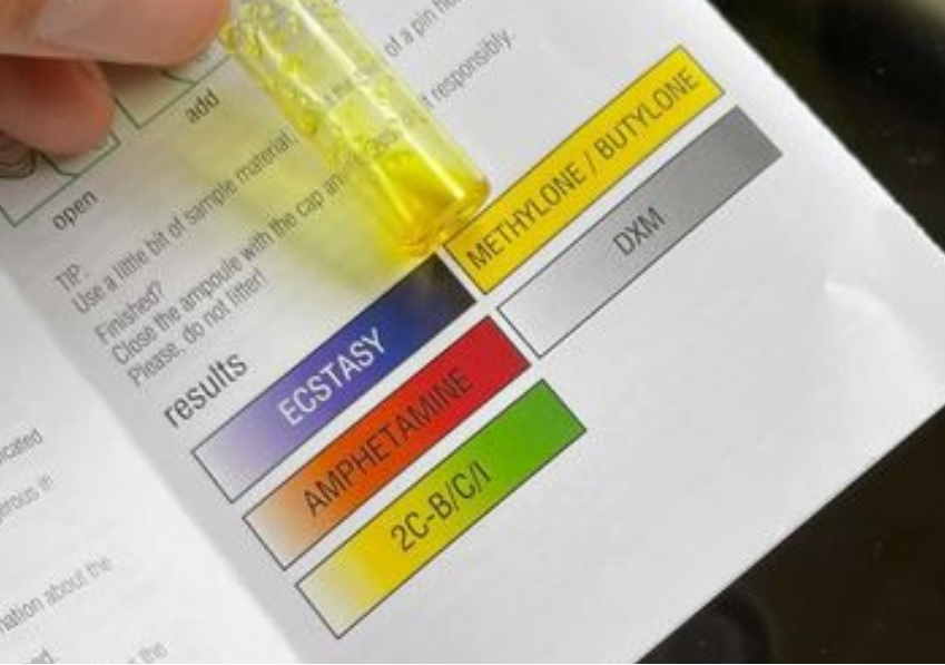 Image of a EZ Ecstasy test with cathinone. The reagent has gone bright yellow.