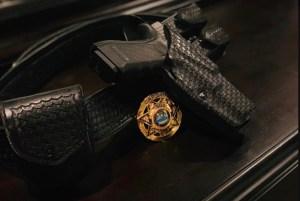 Dutybelt, badge, and gun lying on table
