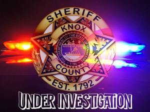 KCSO badge with emergency lights background