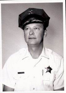 Black and white image of a KCSO officer