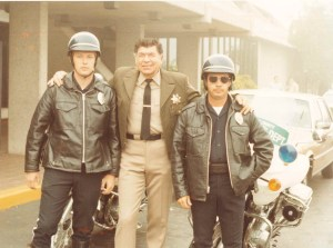Three officers posing together, possibly 1970's