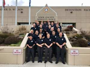 COTA class posing on steps of Detention Facility