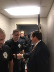 Sheriff shaking hands with COTA students