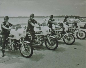 Black and white photo of officers on motorbikes