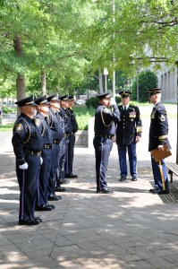Honor Guard standing at attention and saluting