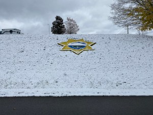 Snow covered KCSO badge at Detention Facility