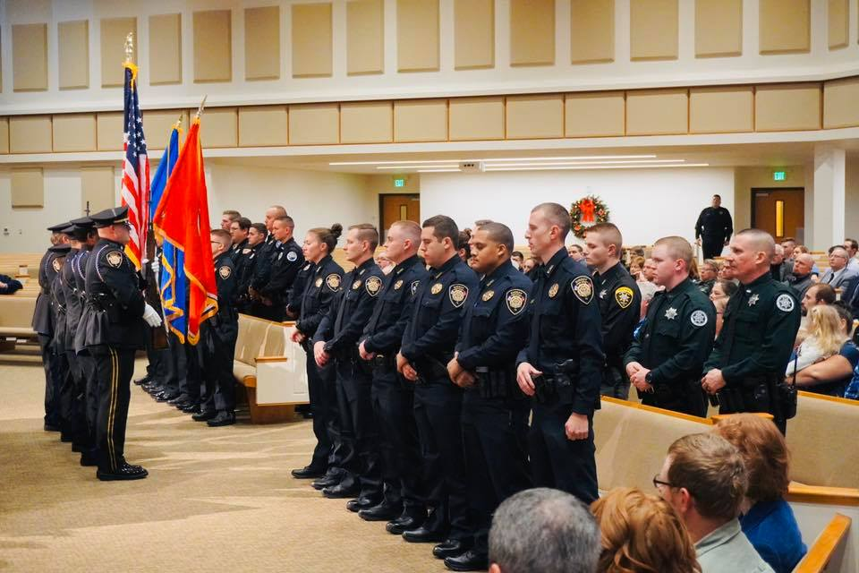 Recruits, Honor Guard, and family at Academy graduation
