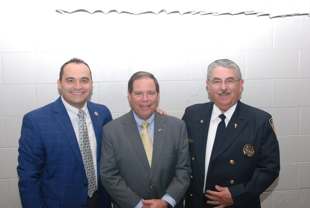 Sheriff and two chaplains smiling at camera