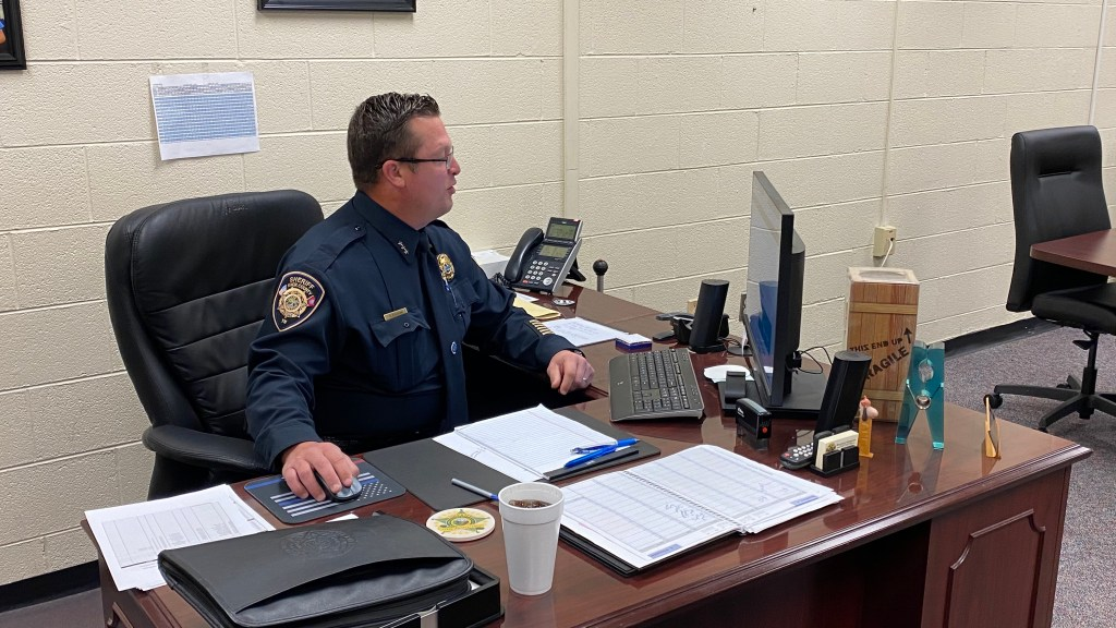Chief Workman working at his desk