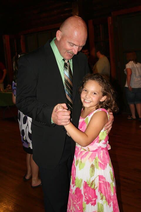 Chief Purvis dancing with daughter