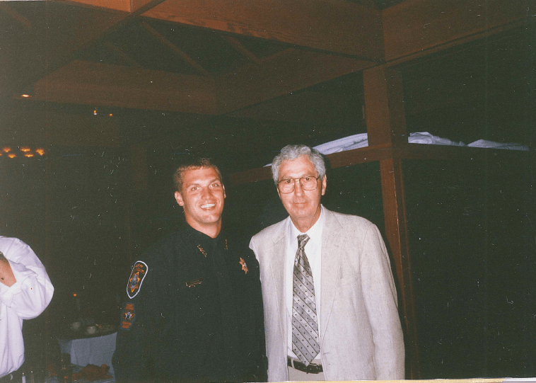 Chief Workman in uniform smiling with father