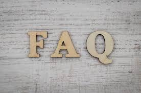 FAQ on wooden backdrop