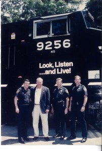 Officers and Phillip Fulmer standing in front of train