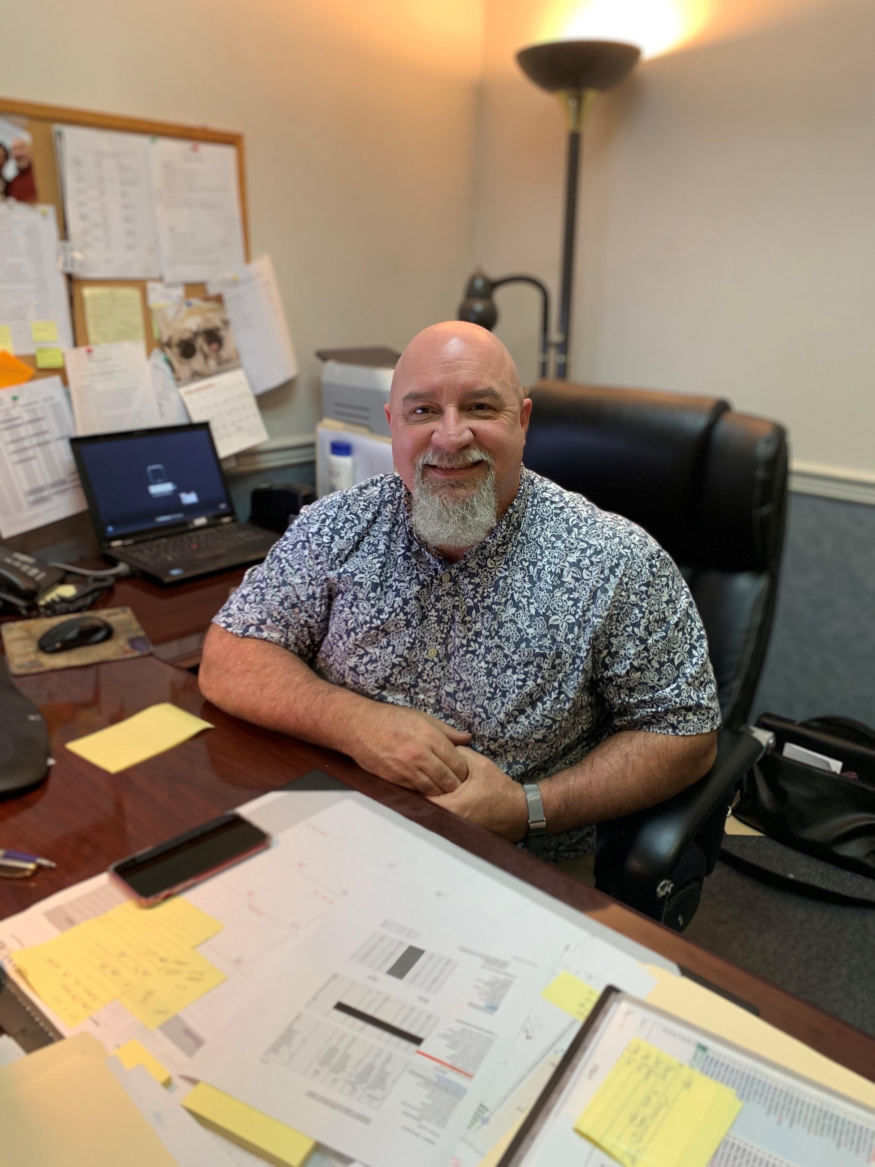 Russ Hatcher sitting at desk