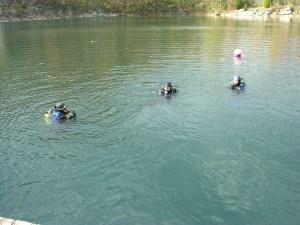 SURT officers in SCUBA gear treading water