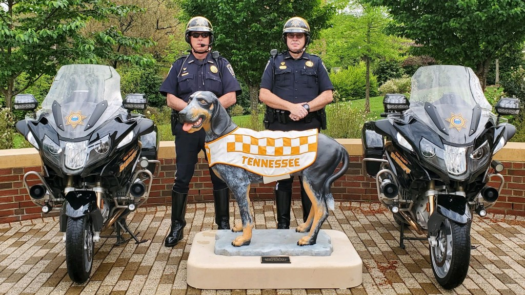 Two motorbike Deputies standing next to Tennessee Vols Mascot statue with motorbikes