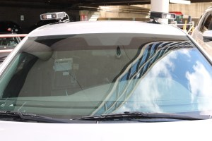 Front windshield of grey cruiser with cameras mounted