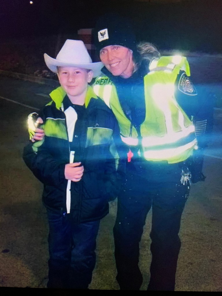 KCSO officer with young boy wearing cowboy hat