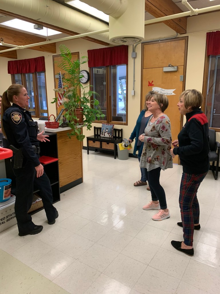 KCSO Officer standing and talking with three teachers