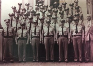 Black and white image of Sheriff deputies standing on steps