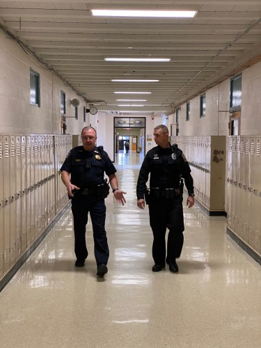 KCSO officer and School Resource officer walking down school hallway