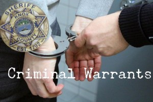 Placing handcuffs on wrists with Sheriff badge in corner