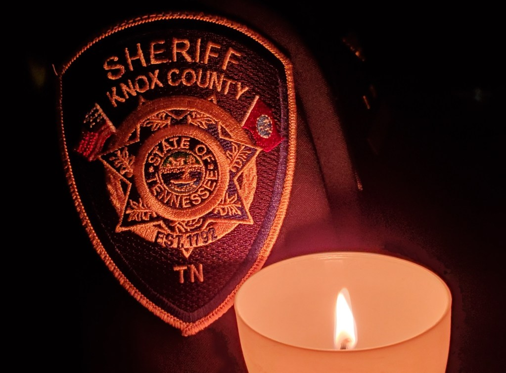 KCSO shoulder patch with lighted candle