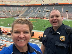 Officers smiling at camera while standing inside Neyland Stadium