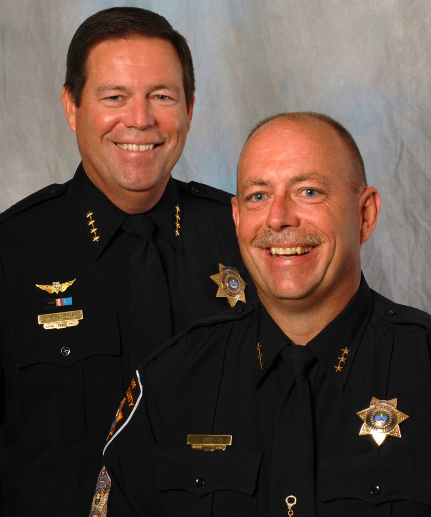 Sheriff Spangler and brother posing and smiling when both were chiefs