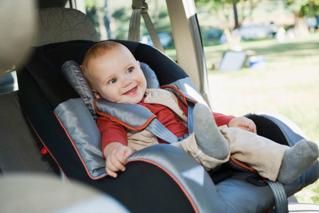 Baby smiling in carseat
