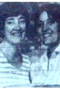 Black and white image of Williams sisters smiling together