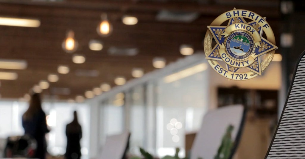 Blurred office background with Sheriff badge in corner