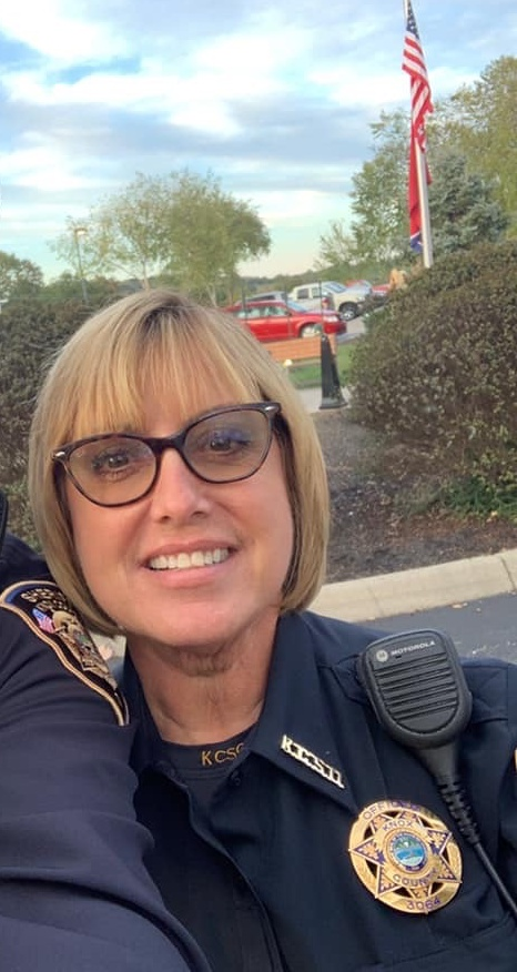 Female sheriff deputy with glasses