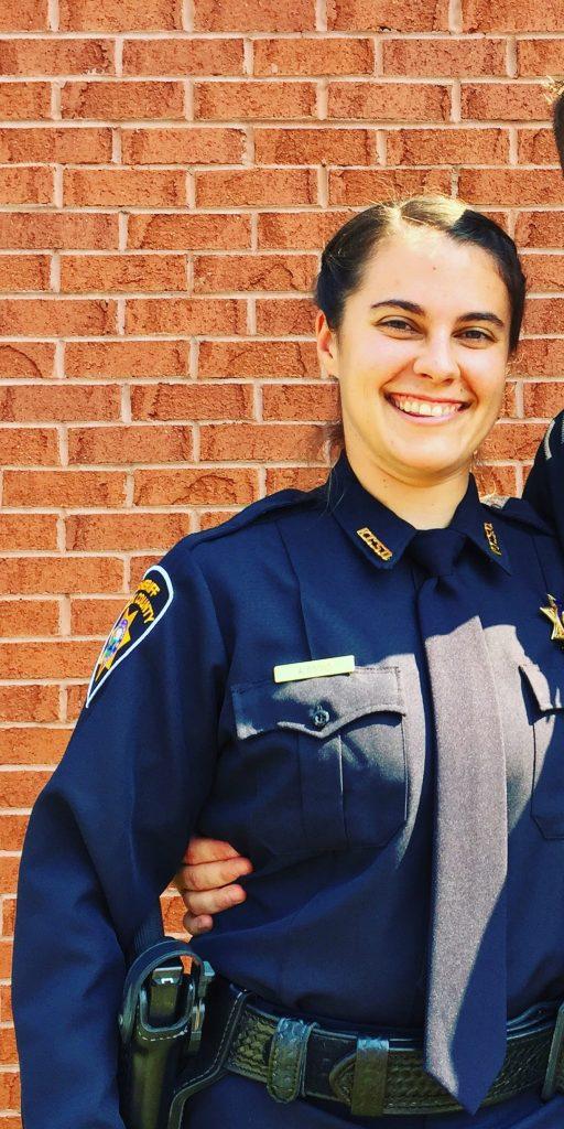 Smiling female sheriff deputy