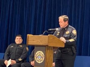 Sheriff speaking at a podium