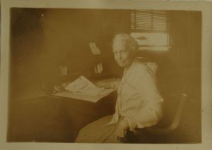 Margaret Q.Adams at desk