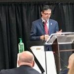 Mullinax speaking at podium