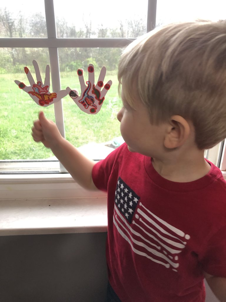 boy giving thumbs up to his hand cutouts