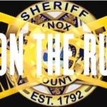 "KCSO badge with caution tape crossing and ""on the run"" overlay"