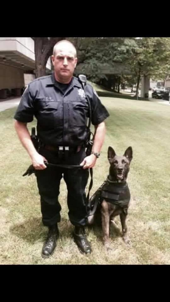 Officer standing with k9
