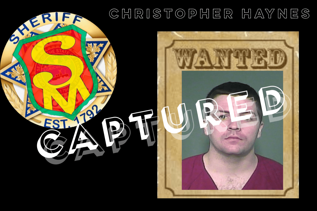 "Mugshot of white male, short dark hair on wanted poster with SafetyMan badge overlayed with ""Captured"""