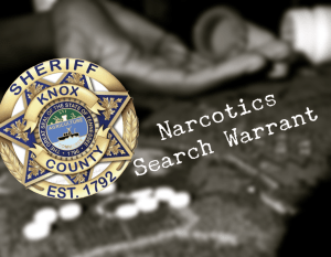 "Sheriff badge over pills and hand with ""Narcotics Search Warrant"""