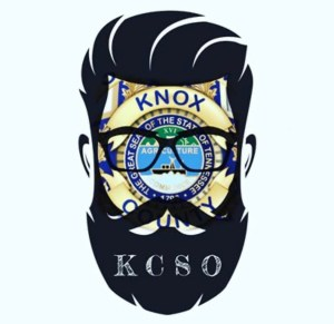 Clipart of man's head with beard and glasses over KCSO badge