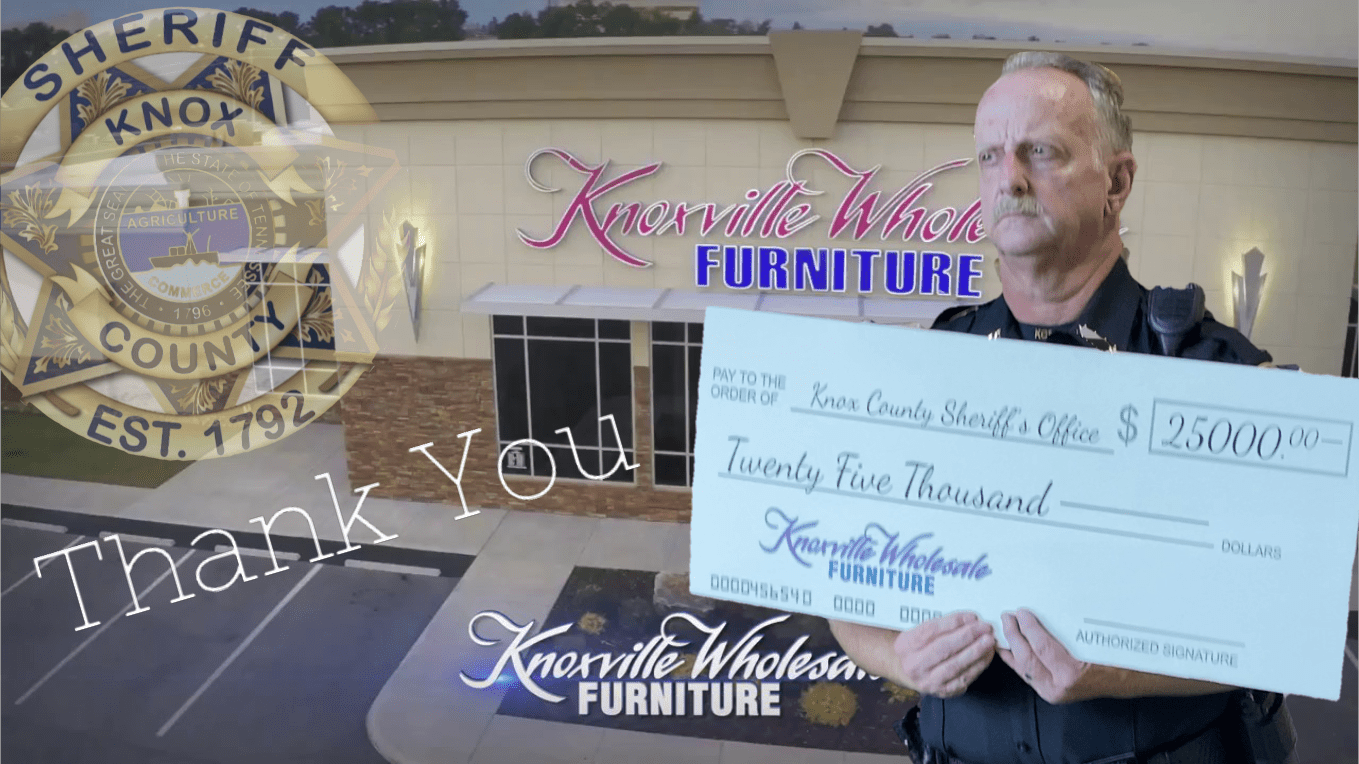 Knoxville Wholsale furniture with Chief Lyon holding large check