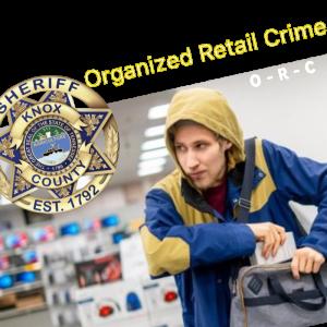KCSO badge in corner with man in hoodie stealing from bag