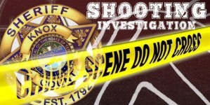 "KCSO badge, crime tape and ""shooting Investigation"""