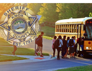 Kids getting on to school bus with KCSO badge overlay
