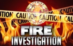 "Flames, with KCSO Badge, caution tape, and ""Fire Investigation"""