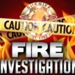 """Flames, with KCSO Badge, caution tape, and """"Fire Investigation"""""""