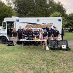Officers posing in front of KCSO van